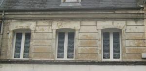 Immeuble de rapport comprenant un local commercial et un apparte